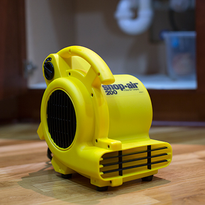SHOP•AIR<sup>®</sup> Air Mover - This compact, high velocity airflow unit can be used to dry wet areas, increase air circulation and assist with cooling.  Air mover features three speeds as well as three operating positions and a 6' power cord.  200 maximum CFM airflow.