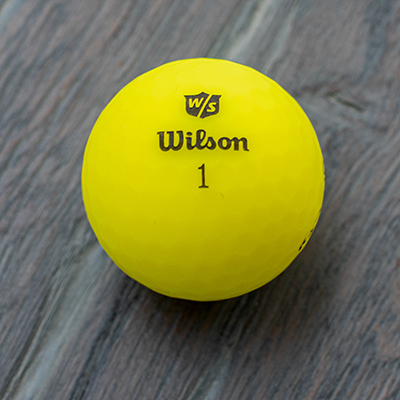 WILSON<sup>&reg;</sup> DUO<sup>&reg;</sup> Optix Yellow Golf Balls - Experience a great game with this set of 12, high-visibility, yellow golf balls.  Revised with a smaller core, DUO<sup>&reg;</sup> Optix now packs more distance than ever before with a matte finish paint to minimize sun glare off the ball, exceptional feel, and straighter flight off the tee.