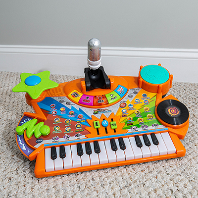 VTECH<sup>®</sup> Record & Learn KidiStudio™ - Your child can sing, record and play back music!  The light-up keyboard features audio recording, voice changer, drum sounds, sound effects buttons and much more.  Kids can play along with 20 melodies in four popular music styles or make their own music and discover their musical creativity.  Batteries not included.  Recommended for ages 3 - 6 years.