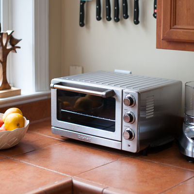 CUISINART<sup>®</sup> Classic Series Convection Toaster Oven Broiler - This brushed stainless steel oven handles all of your countertop cooking needs.  Can be used for toasting, baking, broiling, convection oven cooking and warming.  Simple lines and low profile fit with any kitchen design.  The  0.6 cubic foot stainless steel non-stick interior is also easy to clean and can bake a 12